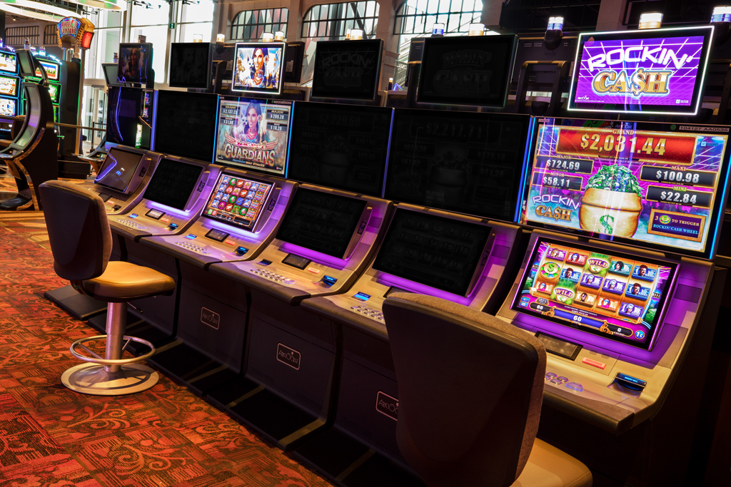 Social distancing at a bank of gaming machines at Club Regent Casino