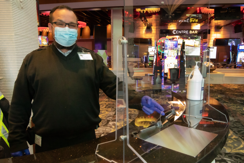 Plexiglass barrier at the Club Regent Casino security desk