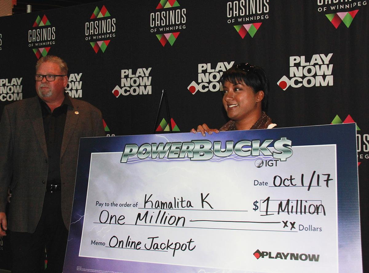 Powerbucks winner Kamalita Ketler accepts her $1 million prize.